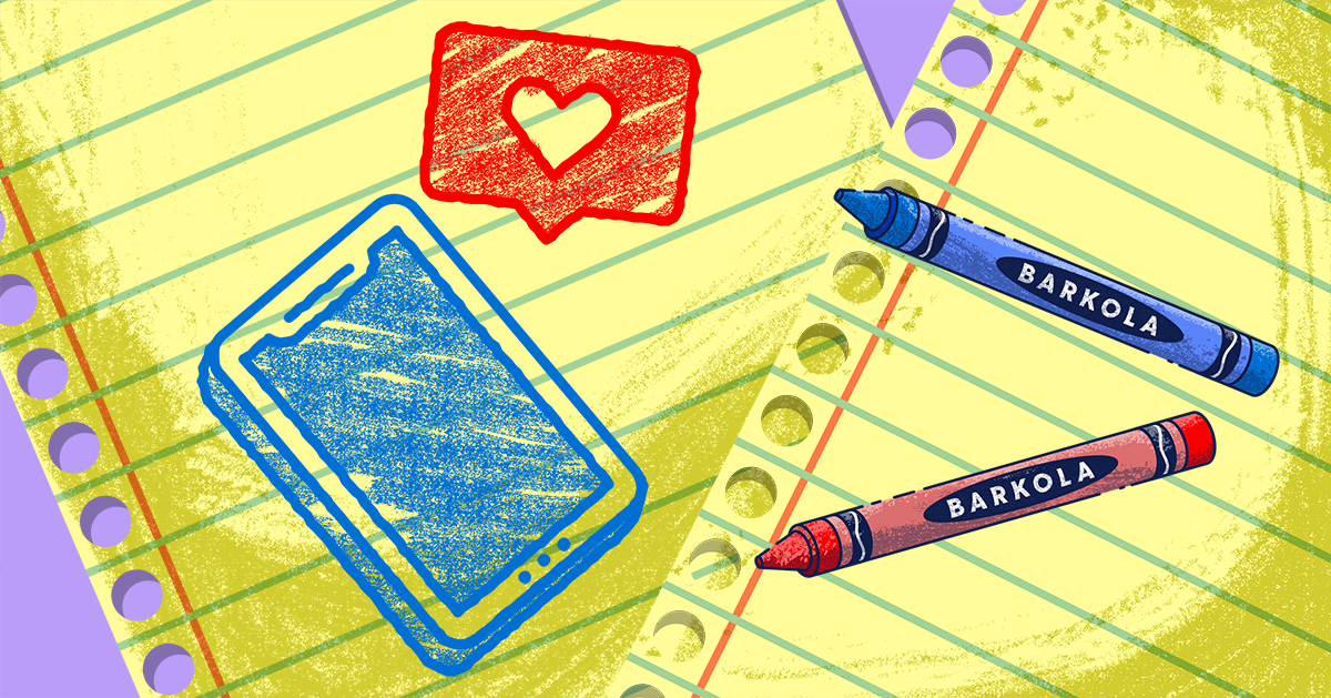 Red and blue crayons on top of notebook paper