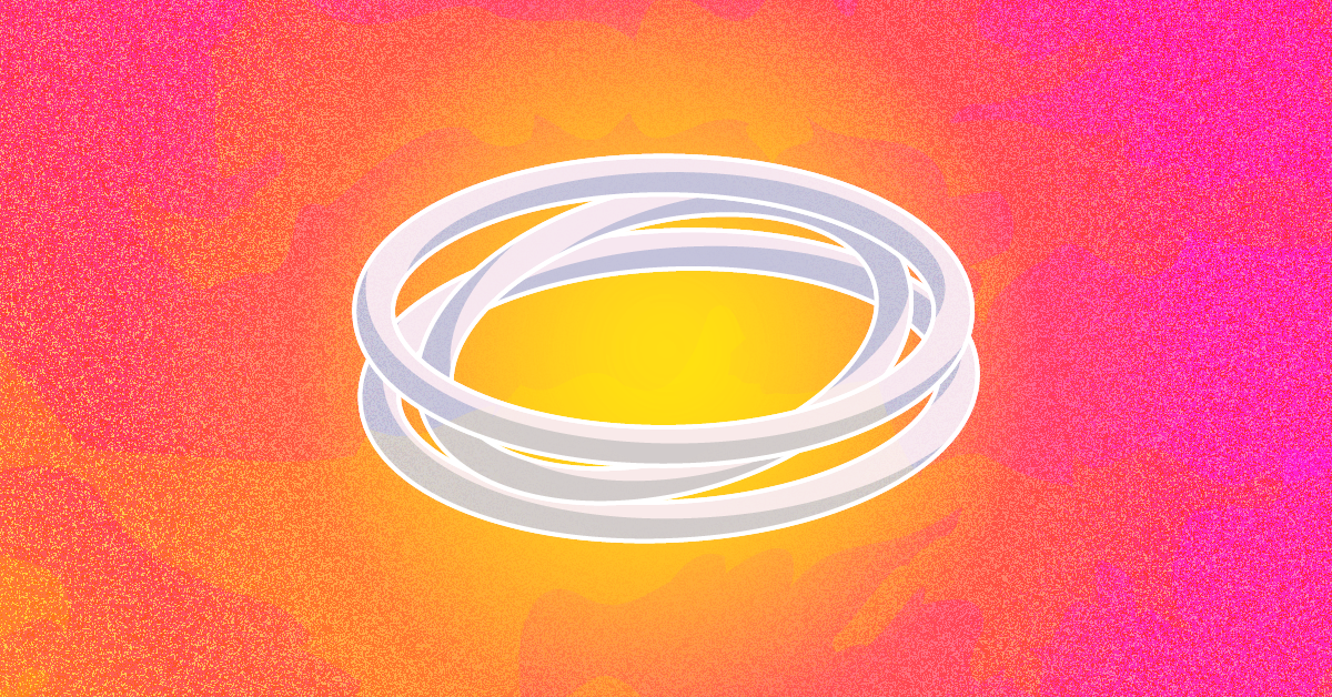 A pile of white rings against a pink and orange background
