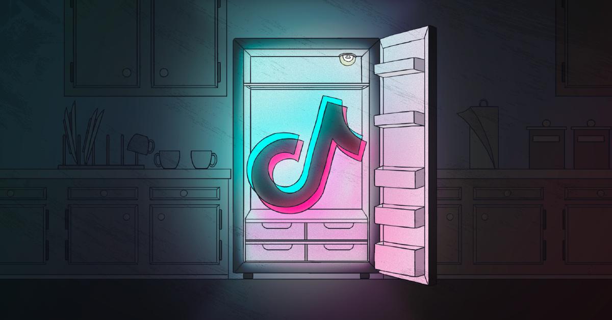 The TikTok logo appearing in a fridge in a dark kitchen